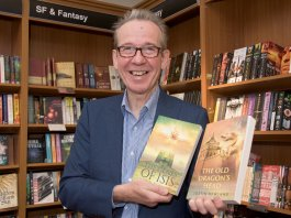 Justin Newland with copies of his books, at Waterstones book store.